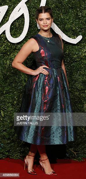 British model Pixie Geldof poses for pictures on the red carpet upon arrival to attend the British Fashion Awards 2014 in London on December 1 2014...