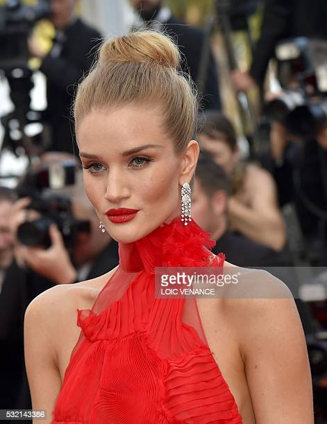 British model Rosie HuntingtonWhiteley poses as she arrives on May 18 2016 for the screening of the film 'The Unknown Girl ' at the 69th Cannes Film...