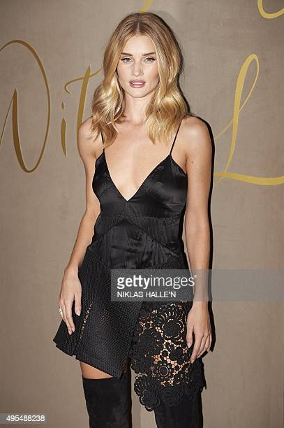 British model Rosie HuntingtonWhiteley poses on arrival for the premiere of the Burberry festive film in London on November 3 2015 AFP PHOTO / NIKLAS...