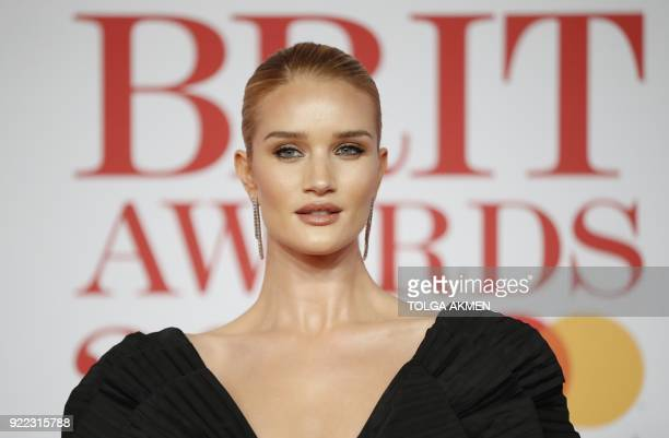 British model Rosie HuntingtonWhiteley poses on the red carpet on arrival for the BRIT Awards 2018 in London on February 21 2018 / AFP PHOTO / Tolga...