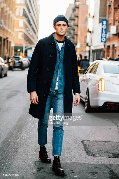British model Tom Barker exits the Nautica show at Skylight Modern in Chelsea wearing Ralph Lauren RRL and APC a blue beanie navy blue peacoat fitted...