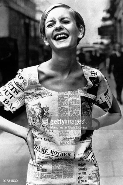 British model Twiggy wearing a 'newspaper' dress