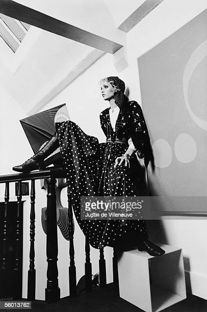 British model Twiggy wearing a polka dot dress and headscarf at the photographer's Notting Hill apartment, 1968.