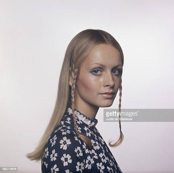 British model Twiggy wears her hair long, with two thin plaits over her ears, circa 1972.