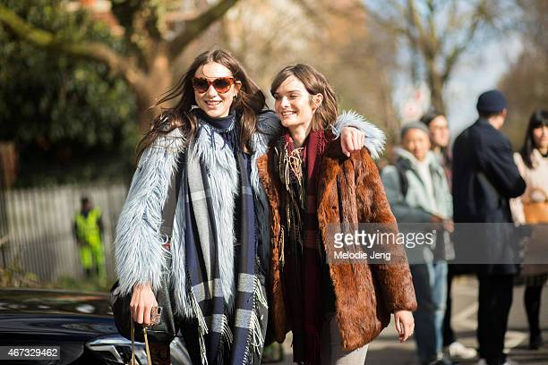 British models Matilda Lowther and Sam Rollinson exit the Burberry show in Burberry scarves during London Fashion Week Fall/Winter 2015/16 at...