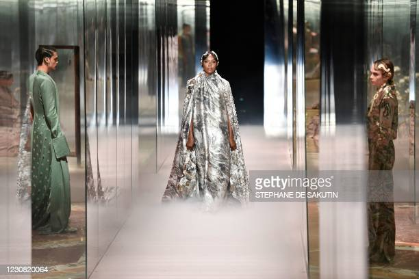 British models Naomi Campbell and Cara Delevingne present creations by British designer Kim Jones for the Fendi's Spring-Summer 2021 collection...