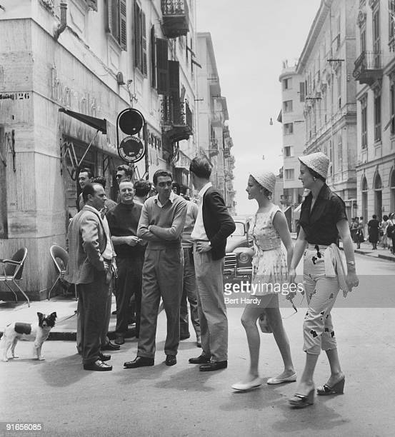 British models Sheila and Jackie take a walk around the Italian city of San Remo during a cruise of the Cote d'Azur July 1955 Original Publication...