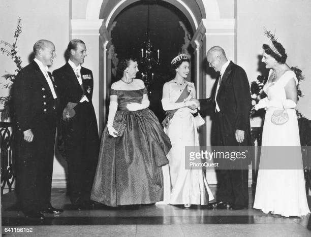 British monarch Queen Elizabeth shakes hands with US President Dwight D Eisenhower at the White House during a state visit Washington DC 1957 Also...
