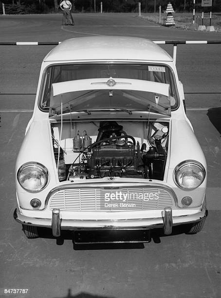 A British Motor Corporation Mini car with the bonnet open to reveal the transverse engine during a demonstration day at the Fighting Vehicles...