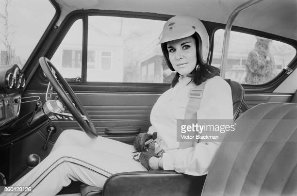 British motor racing driver Anita Taylor sitting inside her Ford Anglia 27th March 1967