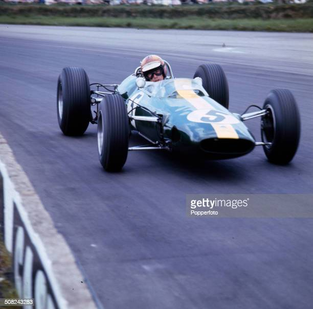 British motor racing driver Mike Spence drives a Lotus during the 17th International Trophy race at Silverstone in Northamptonshire England on 15th...