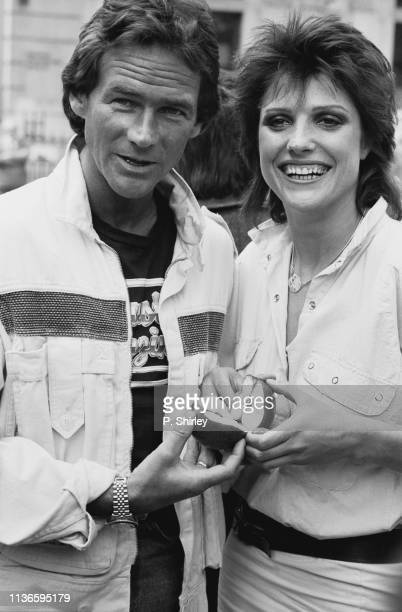 British motorcycle racer Barry Sheene and English actress Suzanne Danielle sharing an apple UK 2nd May 1984