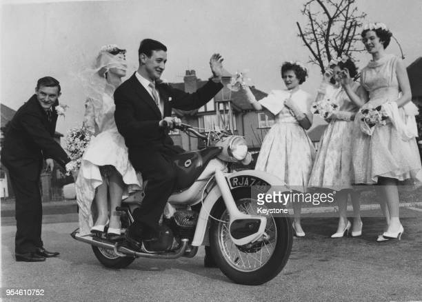 British motorcycle racer Dave Chadwick carries his new bride Judith Stoney away on a motorbike after their wedding at Norbury Church, Hazel Grove,...