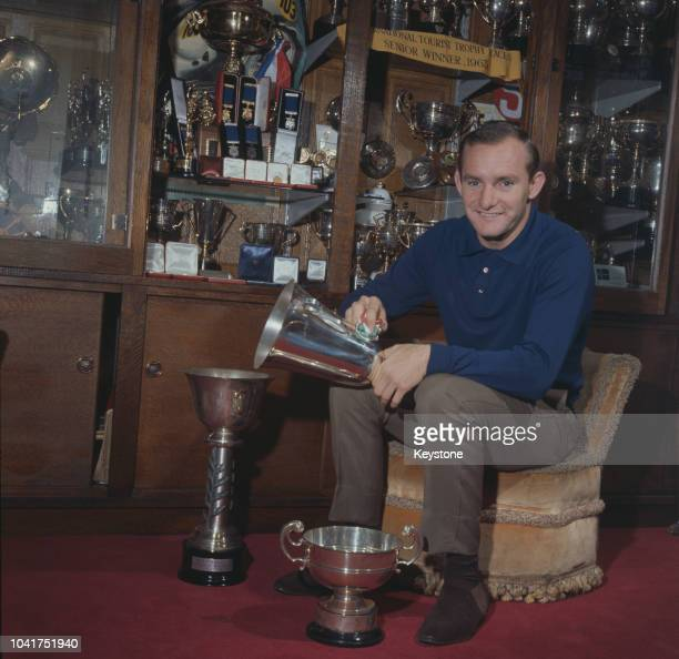 British motorcycle racing champion Mike Hailwood with some of his trophies in Oxford, England, 1st January 1965.
