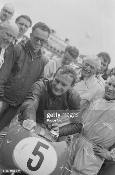 British motorcycle road racer Mike Hailwood pictured on his MV Agusta 500cc motorbike after competing to win the 1965 Isle of Man senior TT 500cc...