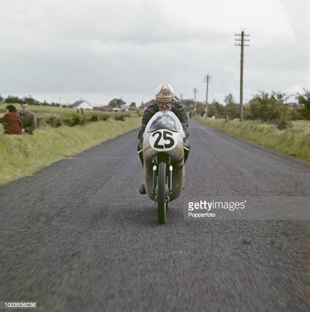British motorcycle road racer Mike Hailwood pictured riding a 250cc Honda motorbike on a public road in September 1961. Mike Hailwood would go on to...