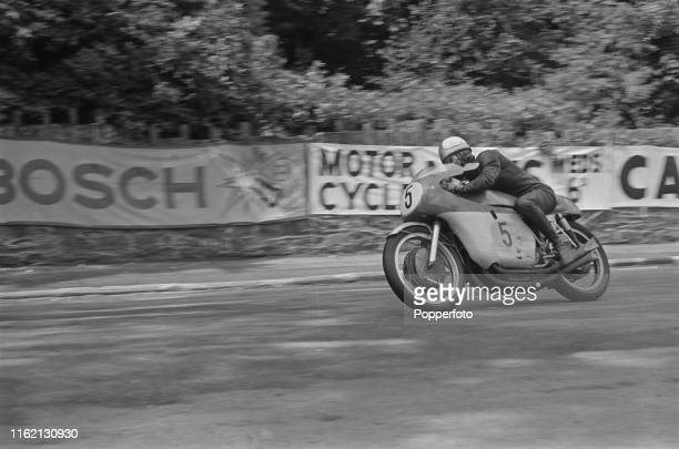 British motorcycle road racer Mike Hailwood pictured riding his MV Agusta 500cc motorbike to win the 1965 Isle of Man senior TT 500cc race in June...