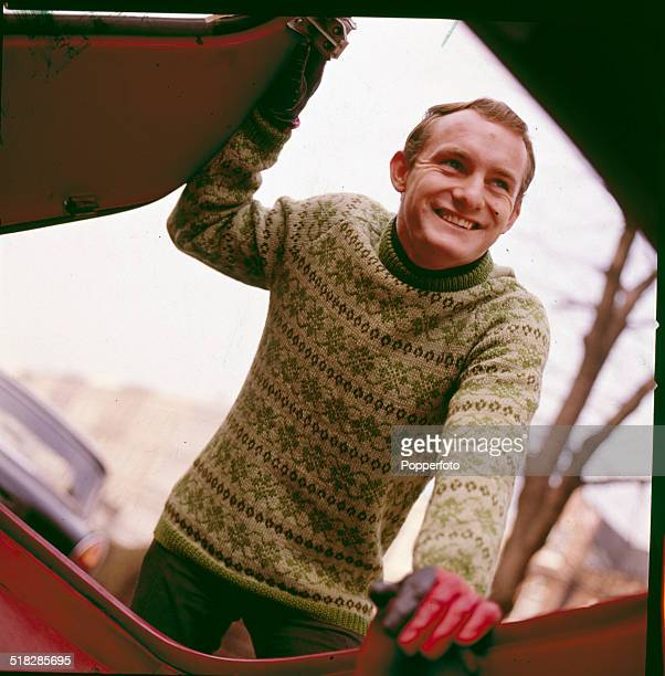 British motorcycle road racer Mike Hailwood posed wearing a knitted Fair Isle jumper in 1965.