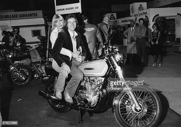 British motorcycling champion Barry Sheene and his girlfriend, glamour model Stephanie McLean, astride his new Suzuki GS750 four-stroke at the Earl's...