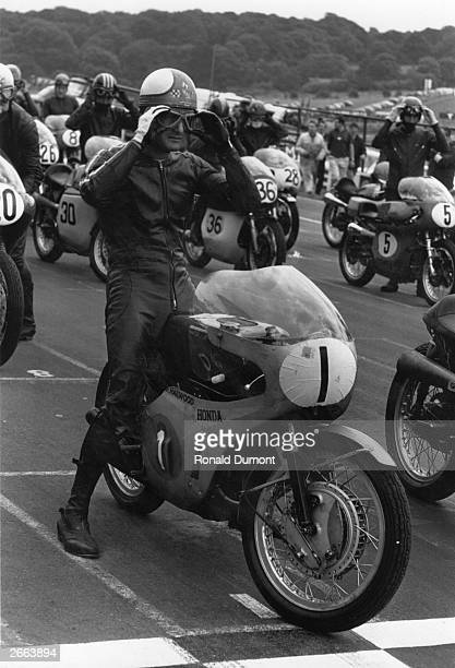 British motorcyclist Mike Hailwood on the start line at Brands Hatch circuit, riding a Honda motorbike.