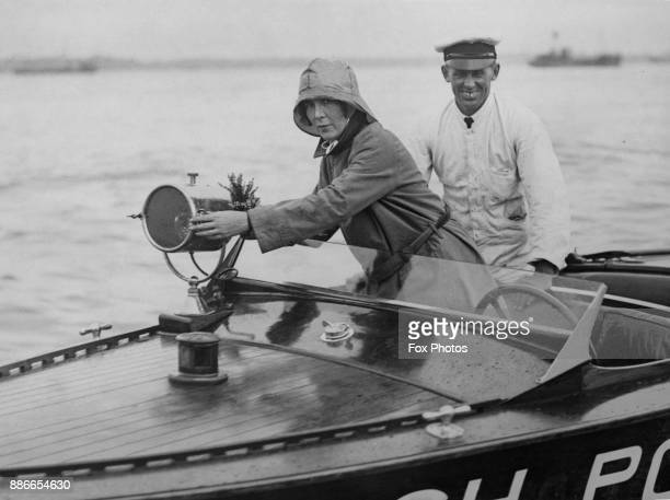 British motorist and speedboat racer Mrs Victor Bruce adjusts the searchlight on her British Power Boat before attempting an endurance record for...