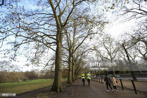 British mounted police patrol at Hyde Park during the last days of autumn on October 28 2017 in London England