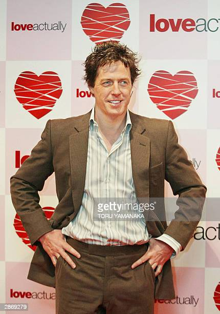 British movie star Hugh Grant poses for photographers during the photo session before a press conference in Tokyo, 15 January 2004, to promote his...