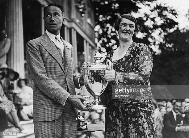 British MP Sir Philip Sassoon presents the trophy to Miss Winifred Brown after her victory in the famous King's Cup Air Race
