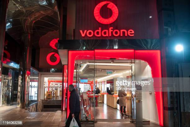 British multinational telecommunications corporation and phone operator, Vodafone, store seen in Spain.