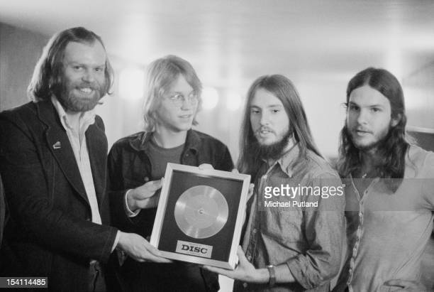 British music presenter Bob Harris presents an award from the music magazine Disc And Music Echo to AngloAmerican folk rock band America at the Royal...