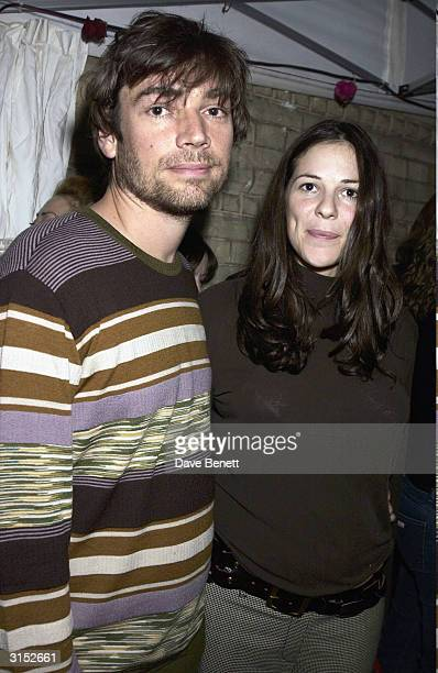 British musician Alex James and girlfriend attend the Helena Christensen 'Icons and Portraits' photography exhibition held at the Proud Gallery as...