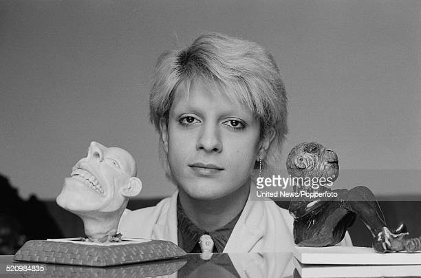 British musician and bass player with the group Japan Mick Karn pictured with various sculpture artworks in London on 12th June 1980