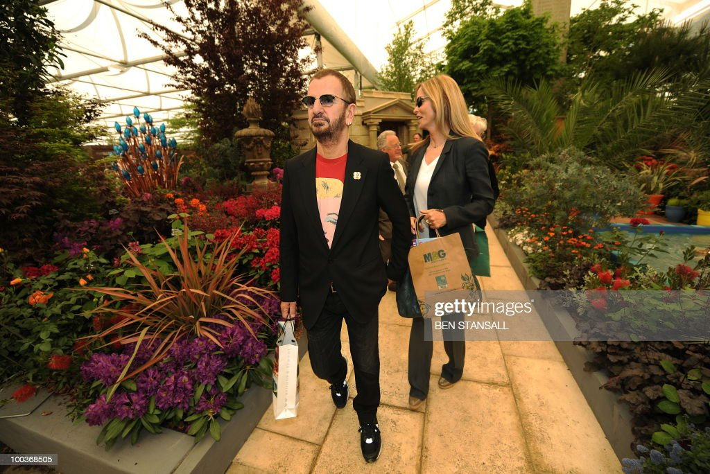 British musician and former Beatle Ringo Starr (L) and wife Barbara Bach, attend the Chelsea Flower Show in London, on May 24, 2010. Garden designers have had to cope with unseasonal frosts up to a week before the event and possibly the warmest day of the year Monday.