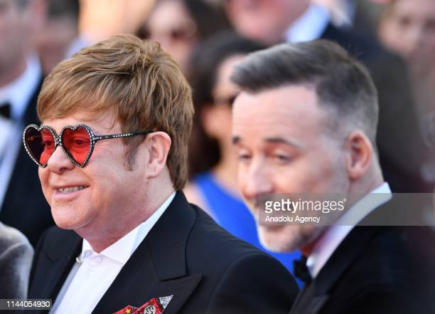 British musician and producer Elton John and Canadian producer David Furnish arrive for the screening of the film 'Rocketman' during the 72nd annual...