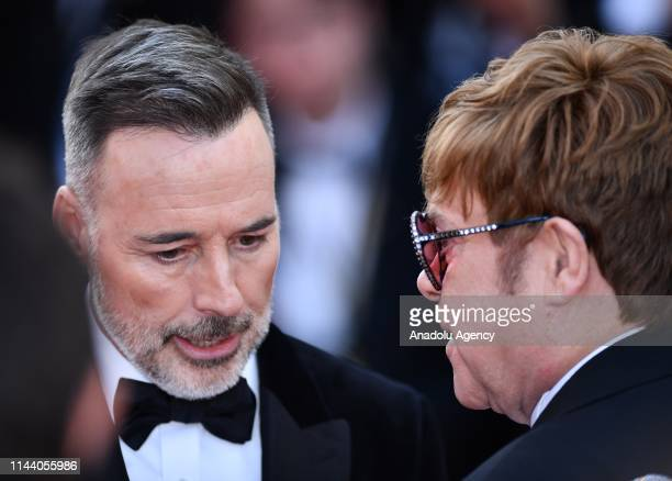 British musician and producer Elton John and Canadian producer David Furnish arrives for the screening of the film 'Rocketman' during the 72nd annual...