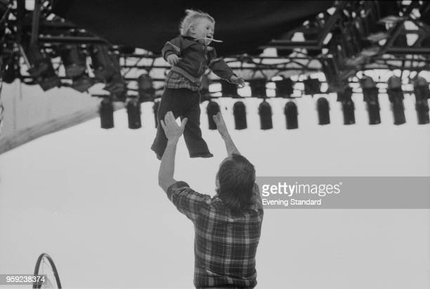 British musician and singersongwriter Phil Collins playing with his son Simon on the stage of A Midsummer Night's Dream festival Knebworth Festival...