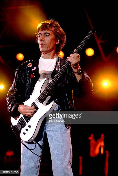 British musician Bill Wyman of the Rolling Stones performs on stage during the band's 'Steel Wheels' tour late 1989