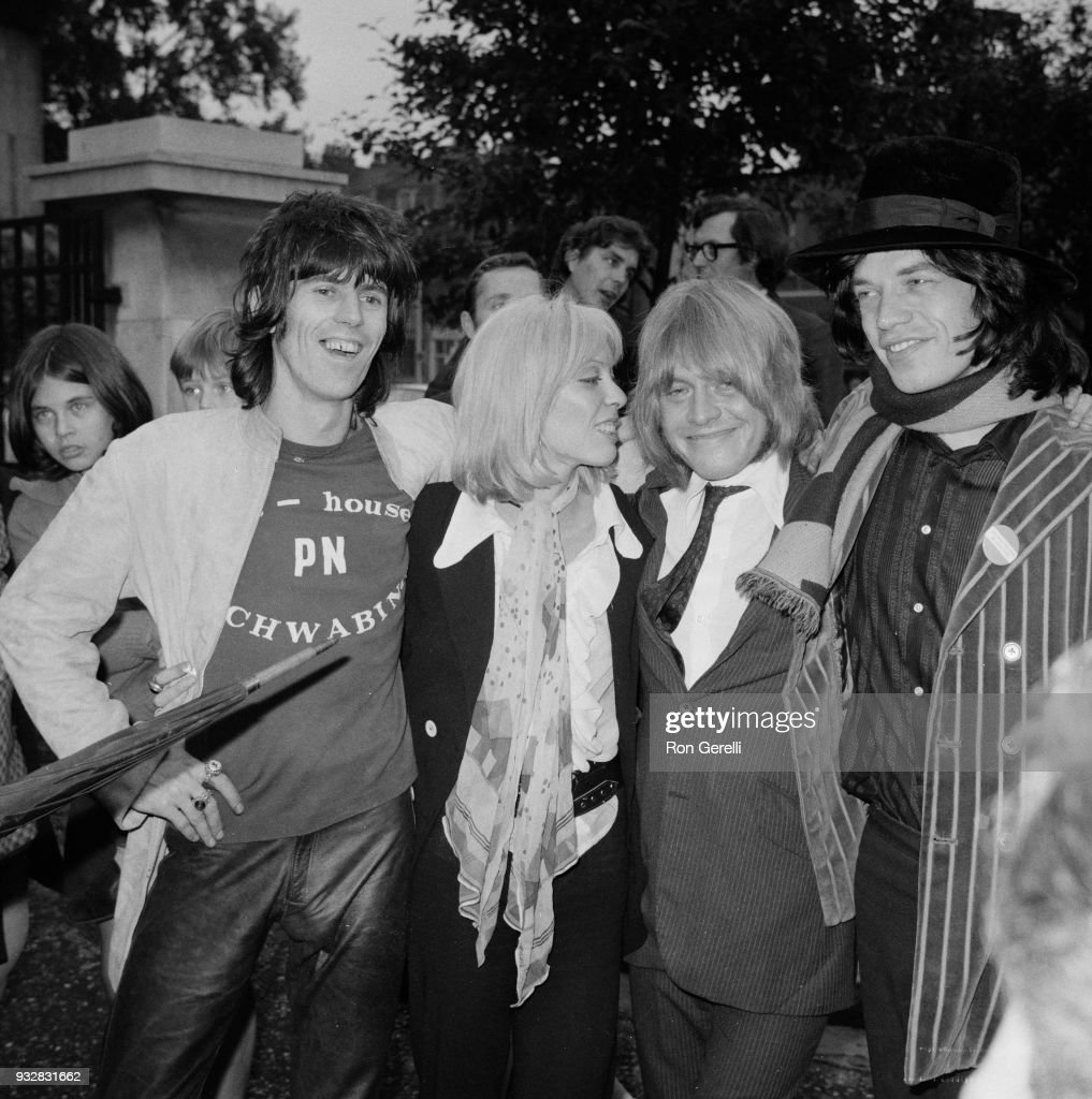 British musician Brian Jones (1942 - 1969) is welcomed by fashion model Suki Portier and musicians Keith Richards and Mick Jagger, after leaving court after being found guilty on a drug charge but released after paying 50£ fine, London, UK, 26th September 1968.