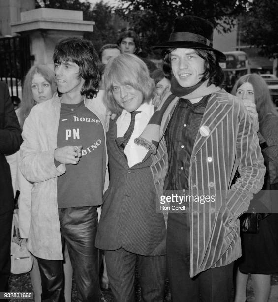 British musician Brian Jones is welcomed by musicians Keith Richards and Mick Jagger after leaving court after being found guilty on a drug charge...