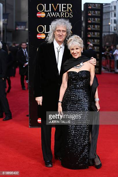British musician Brian May and his wife British actress Anita Dobson pose on the red carpet upon arrival to attend the 2016 Laurence Olivier Awards...