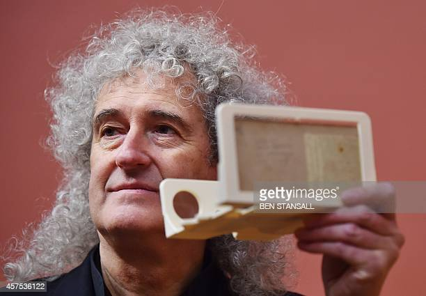British musician Brian May poses with an owl viewer in front of John Everett Millais painting 'Hearts are Trumps' in 1872 which was inspired by...