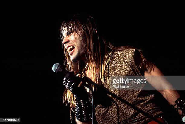 British musician Bruce Dickinson, vocalist for the band Iron Maiden, performs onstage at the University of Illinois Pavilion, Chicago, Illinois,...