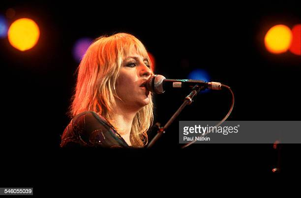 British musician Christine McVie, of the group Fleetwood Mac, performs onstage at the Alpine Valley Music Theater, East Troy, Wisconsin, July 19,...