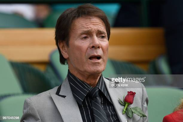 British musician Cliff Richard sits on centre court before watching US player Serena Williams play Germany's Julia Goerges during their women's...