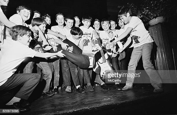 British musician David Daltrey is held by choristers from the Colet Court School during rehearsals for Tim Rice and Andrew Lloyd Webber's 'Joseph and...
