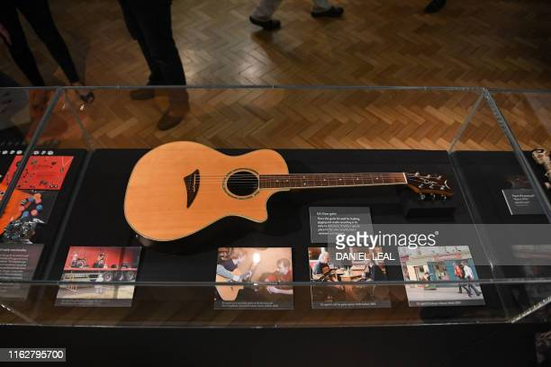 British musician Ed Sheeran's 'Dean' guitar used by the artist for busking gigging and studio recoring in his early to midteens is pictured during a...