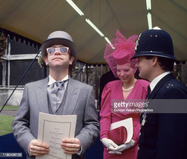 British musician Elton John with his former wife Renate Blauel attending the wedding of Prince Andrew the Duke of York and Sarah Ferguson in London...