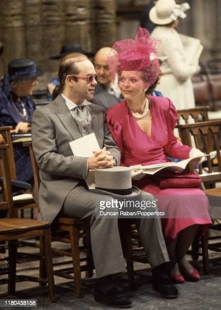 British musician Elton John with his former wife Renate Blauel attending the wedding of Prince Andrew the Duke of York and Sarah Ferguson at...