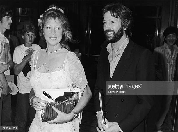 British musician Eric Clapton and his wife Pattie Boyd arrive at the Dominion Theatre in London for a Prince's Trust charity rock concert 20th July...
