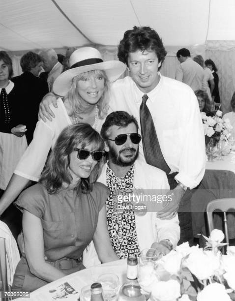 British musician Eric Clapton and his wife Pattie Boyd pose with Ringo Starr and his wife Barbara Bach at a Windsor polo match July 1986